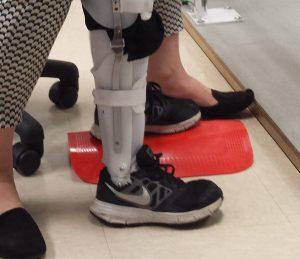 Improvising a lift for Drews left leg.
